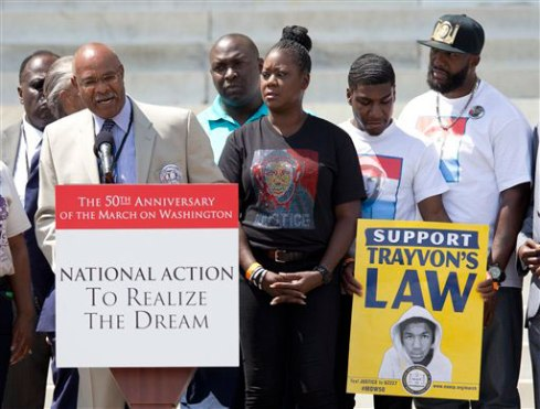 Simeon Wright, Emmett Till's cousin, speaks at the podium in front of the Lincoln Memorial in Washington, Saturday, Aug. 24, 2013, with Sabrina Fulton, mother of slain teenager Trayvon Martin, center, Trayvon's brother Jahvaris Fulton, second from right and Trayvon's father Tracy Martin during the commemoration of the 50th anniversary of the Aug. 28, 1963 March on Washington. (AP Photo/Carolyn Kaster)